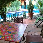 Shady poolside patio at the Bougainvillea bungalow