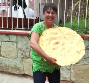 Mary Jane loves Oaxacan culture and cuisine. Here with the biggest tlayuda she's ever found.
